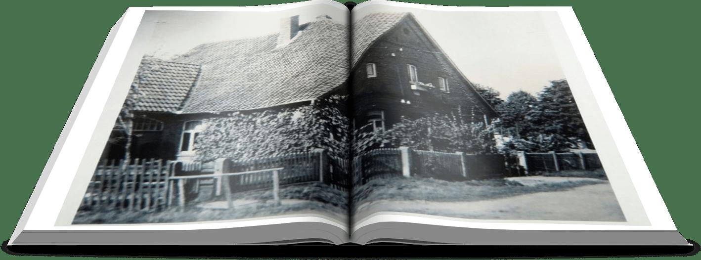 Auf diesem Bild sieht man ein offenes Buch mit einem alten Haus.